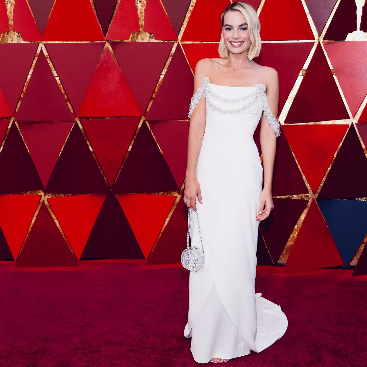 At the #Oscars — House ambassador @MargotRobbie wearing a #CHANELHauteCouture dress on the red carpet at last night's 90th Academy Awards. #CHANELMakeUp #CHANELFineJewelry