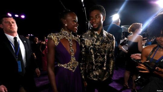 so here are some photos of Black men being captivated by Lupita Nyong'o's beauty...