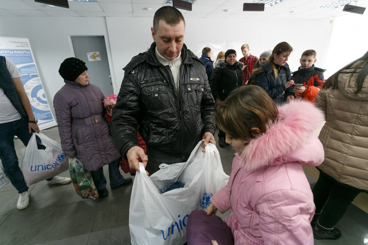 Yurii, 41, collects clothes provided by Swiss Gov.🇨🇭 for his daughter Nadia, 9. He is a single father. Since the beginning of conflict, conditions of their life in Donetsk significantly deteriorated. I want my daughter to have nice clothes and everything she needs, says Yurii