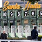 Image for the Tweet beginning: Heavy rain forces Santa Anita