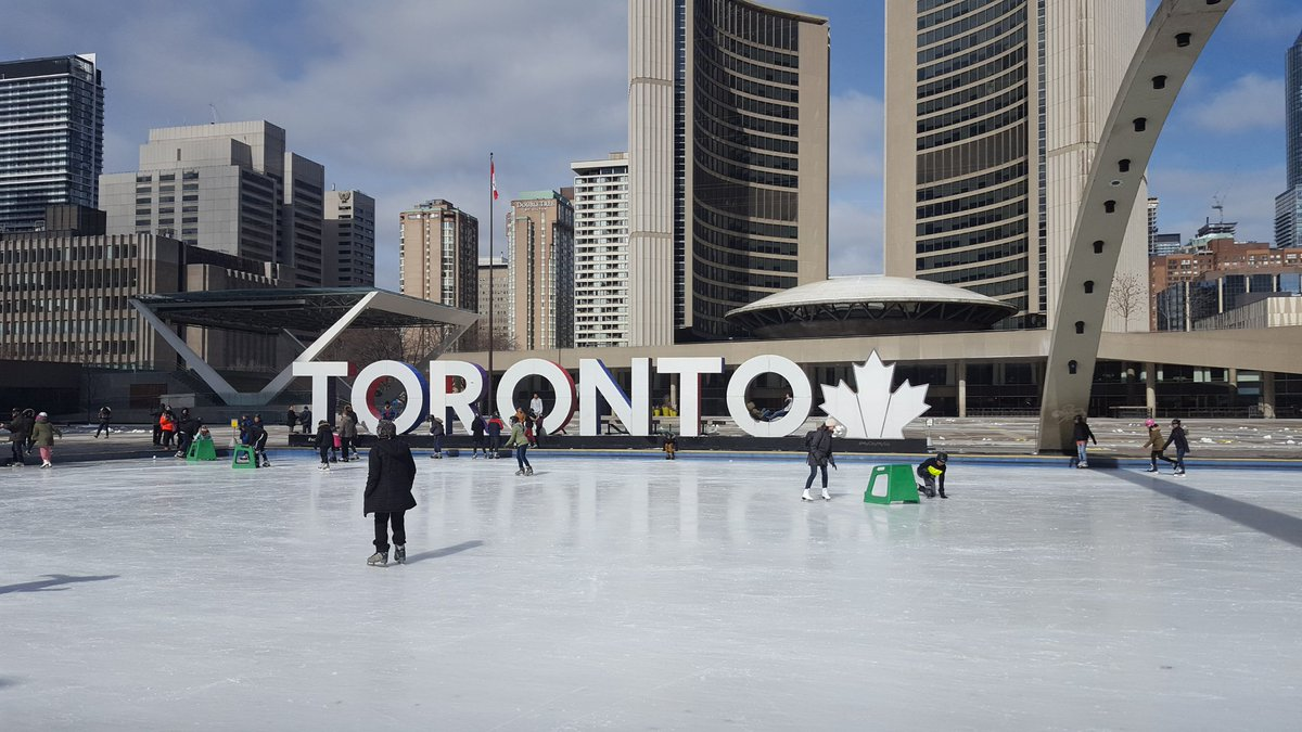 Nathan Phillips Square, Toronto, Canada, with the TORONTO sign adjacent tho the ice rink