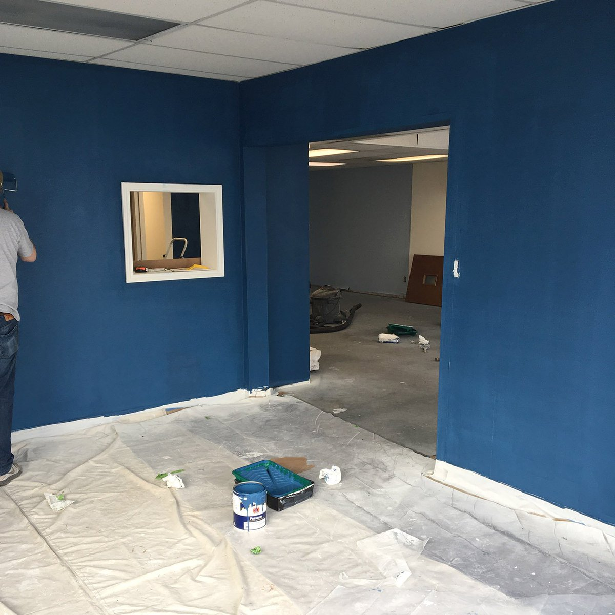 Working hard on the new office space... coming together! Dark blue ftw and love the new slot wall for samples.   #newofficespace <br>http://pic.twitter.com/UNcAON0Pg7