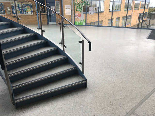 Stunning #resin #flooring installed in a school in #Manchester using our #Monarflake system with a grey/white blend ...