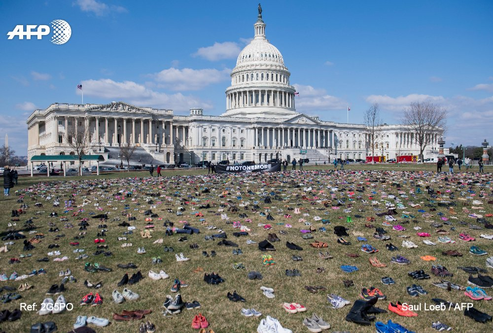 The lawn outside the US Capitol is covered with empty shoes to represent the 7,000 children killed by gun violence since the 2012 shooting at Sandy Hook Elementary School