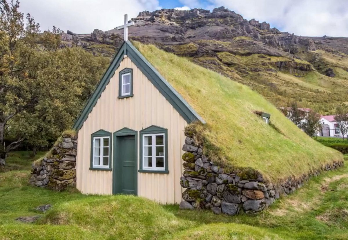 Grass covered A-frame Church in Iceland,...