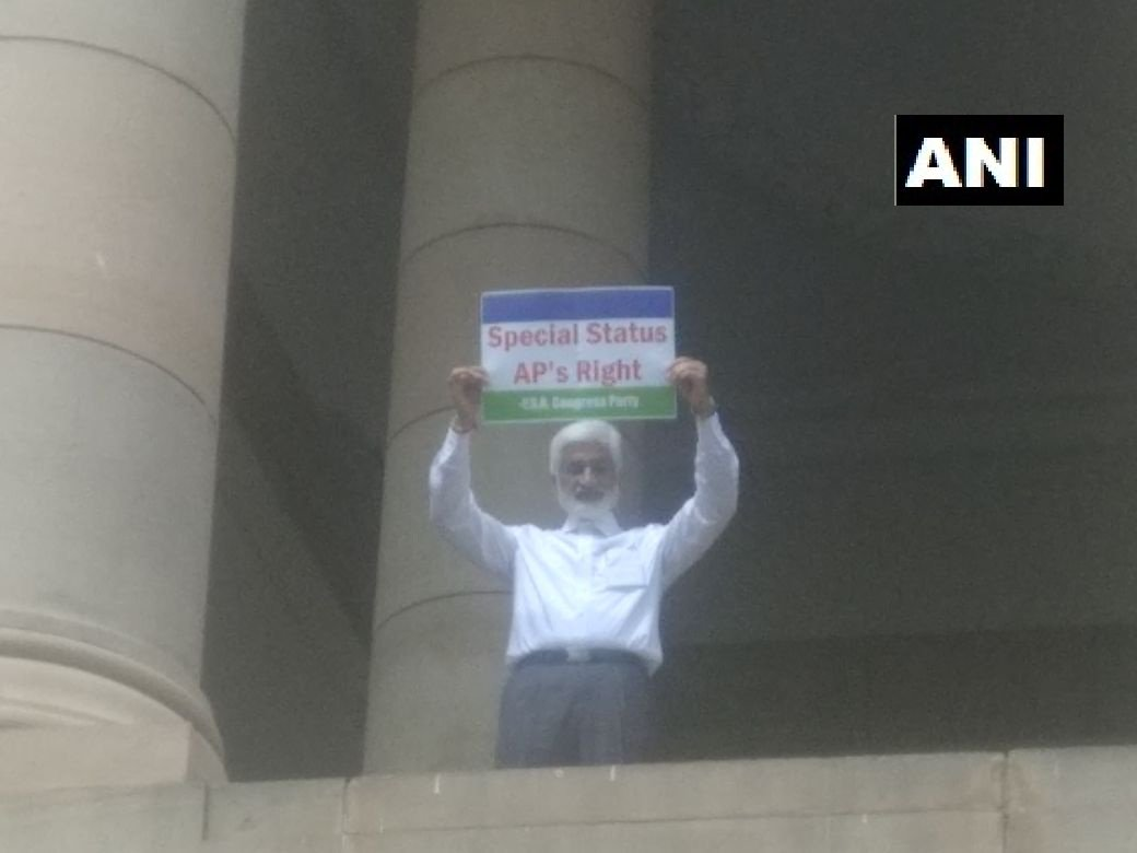YSR Congress Party MP Vijaya Sai Reddy protest on first floor of Parliament demanding special category status for Andhra Pradesh.