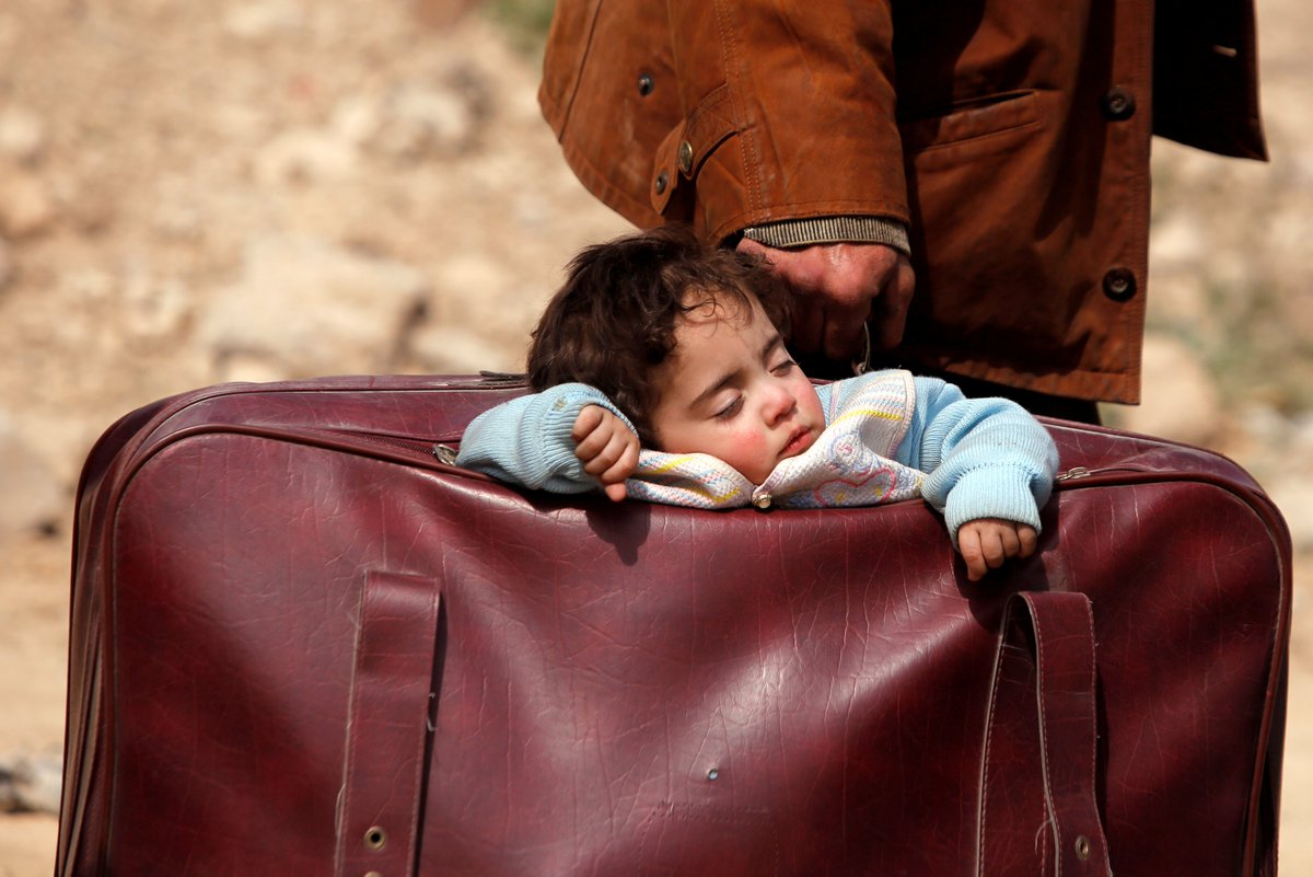 In a single day, an estimated 20,000 Syrian people carried what they could and fled on foot from a government assault in eastern Ghouta.  One man carried a baby in a suitcase.