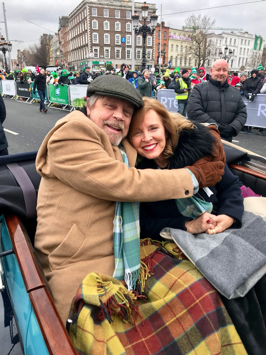 """Happy St. Patrick's Day from the big parade in Dublin Ireland. @HamillHimself &  bra@MarilouHamillving the cold. (One guy in the crowd shouted: """"Use the Force to bring out the Sun!"""") Maybe twin suns on this chilly morning..."""