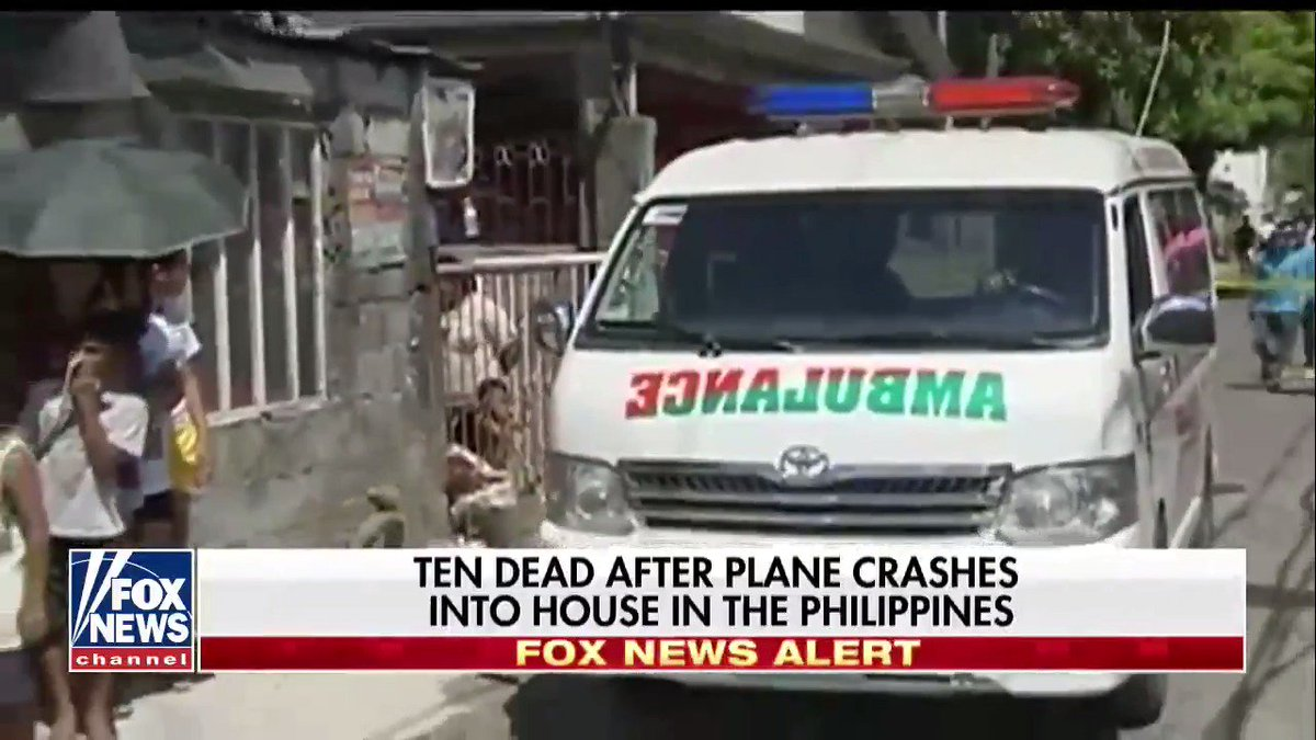 Ten dead after plane crashes into house...