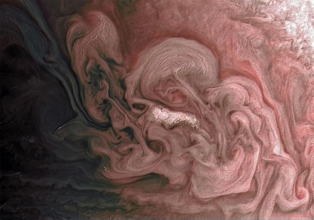 Our @NASAJuno spacecraft captured this close-up view from February 7 of a storm with bright cloud tops on Jupiter. See this rose-colored look at the gas giant planet: https://t.co/wUuNUh15sk