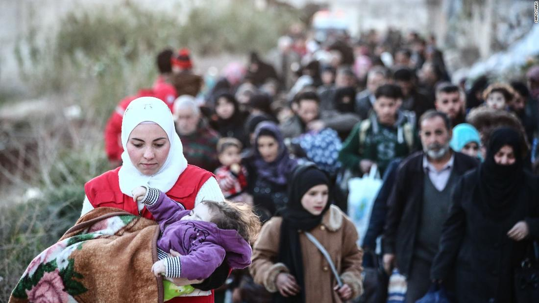 Airstrikes hit Syrian enclave where many...