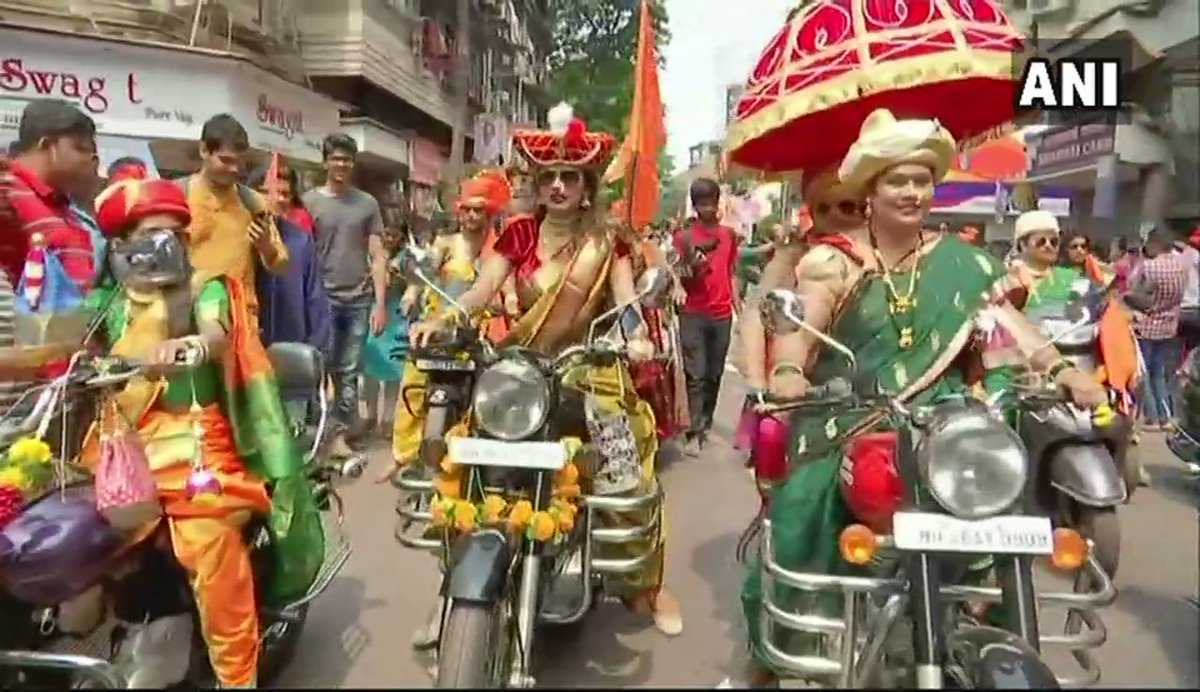 Women ride two wheelers wearing traditional Maharashtrian sarees in Mumbai's Girgaon during #GudiPadwa celebrations.