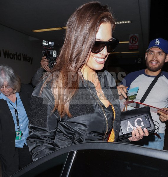 Ashley Graham Sighted at LAX Airport in...