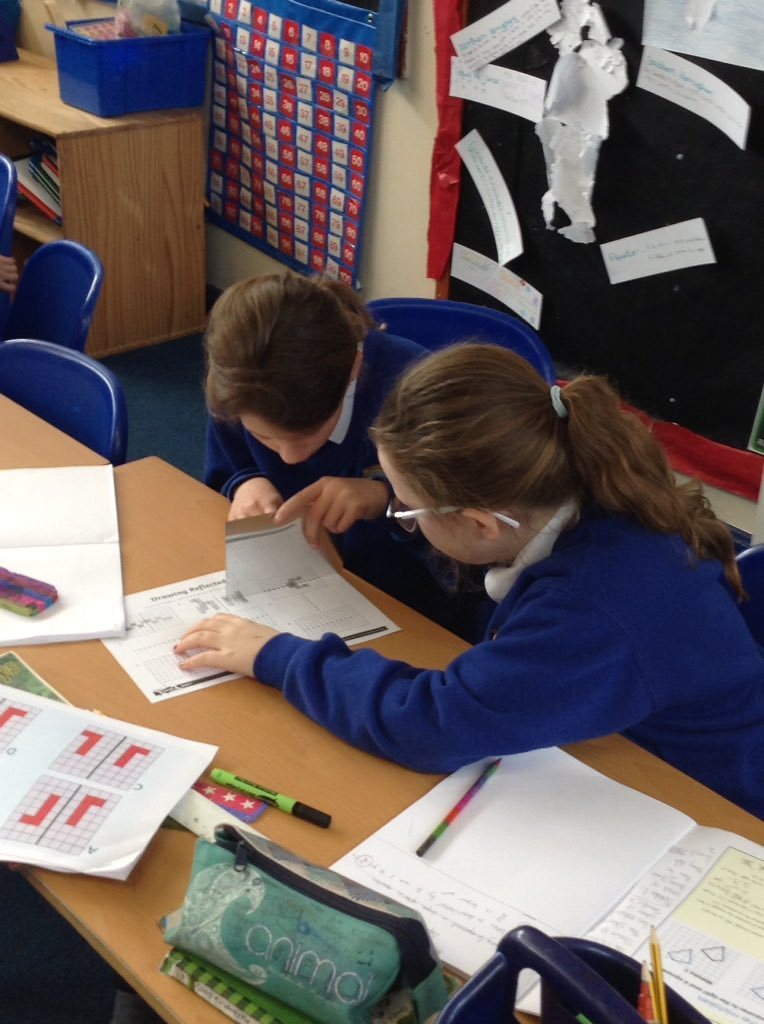 Year 5 experimenting with reflection in Maths