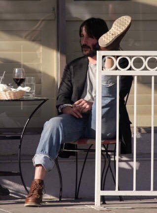 keanu reeves drinking some wine and havi...