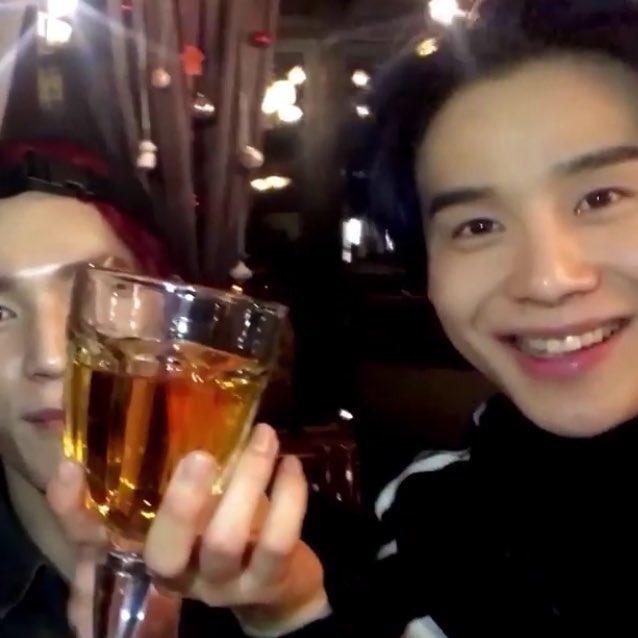 jungwoo drinking apple juice in a wine g...