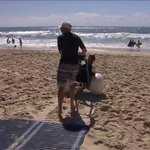 Image for the Tweet beginning: Beachgoers with a disability can