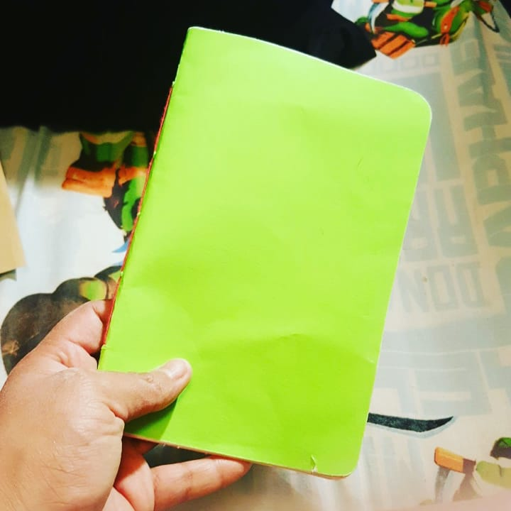 Adventures in bookbinding 2, saddle stitch and a stubborn round corner punch. More neon colours EVERYWHERE.