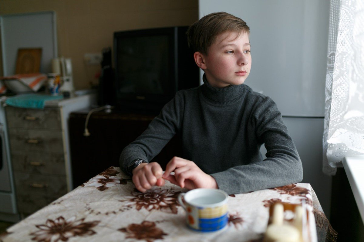 """Maksym is 13. His mother died several years ago, and he lives with his grandparents in #Donetsk. """"Shellings happen very often here. I got used to it, I do not pay attention anymore,"""" he says. UNICEF delivered new clothes to Maksym thanks to support from Gov. of Switzerland🇨🇭"""