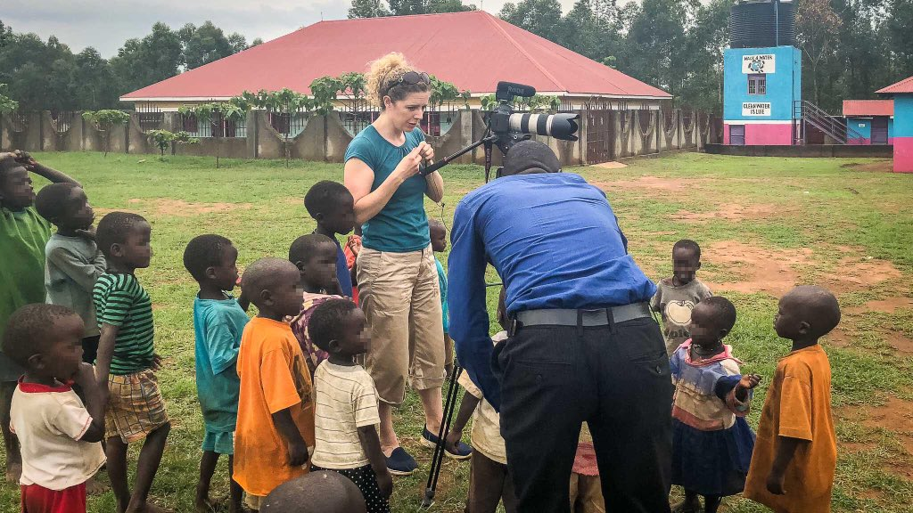 Trying to do some filming at the Smile Africa orphanage in #Tororo, #Uganda. This is my best 'please don't climb on the tripod' face!   #filming #tvproducer #africa #videographer #filmmakinglife  #orphanage #childrenshome #orphans #dontclimb #neverworkwithchildren