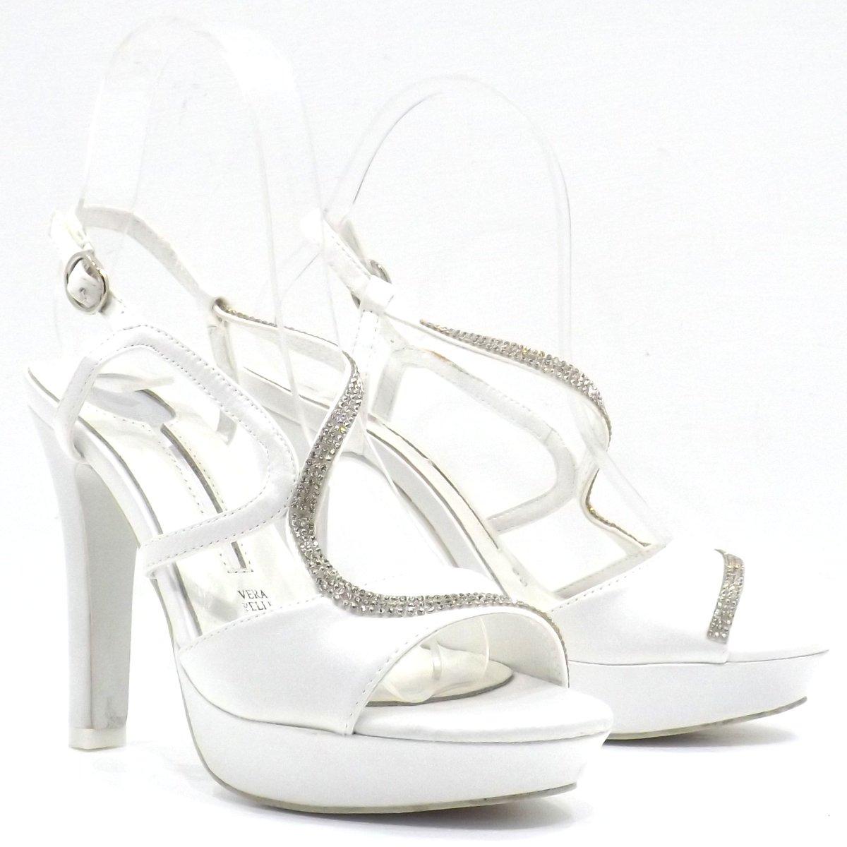 b99839f73683 Altezza tacco   10 cm. Stile  Sandalo fasciato alla caviglia. Colore   Bianco perla. Numero   35
