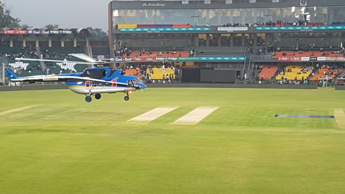 Helicopter arrives at the Gaddafi Stadiu...