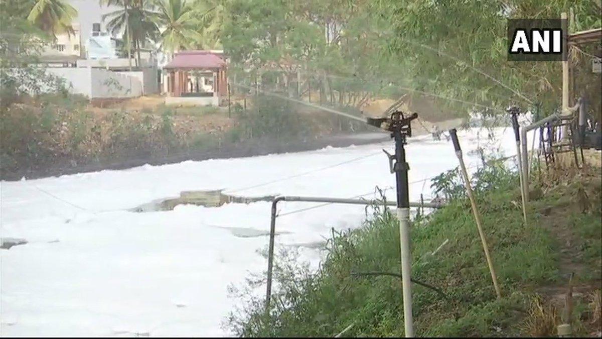 Water being sprinkled as #Bengaluru's Bellandur Lake spills toxic foam. #Karnataka