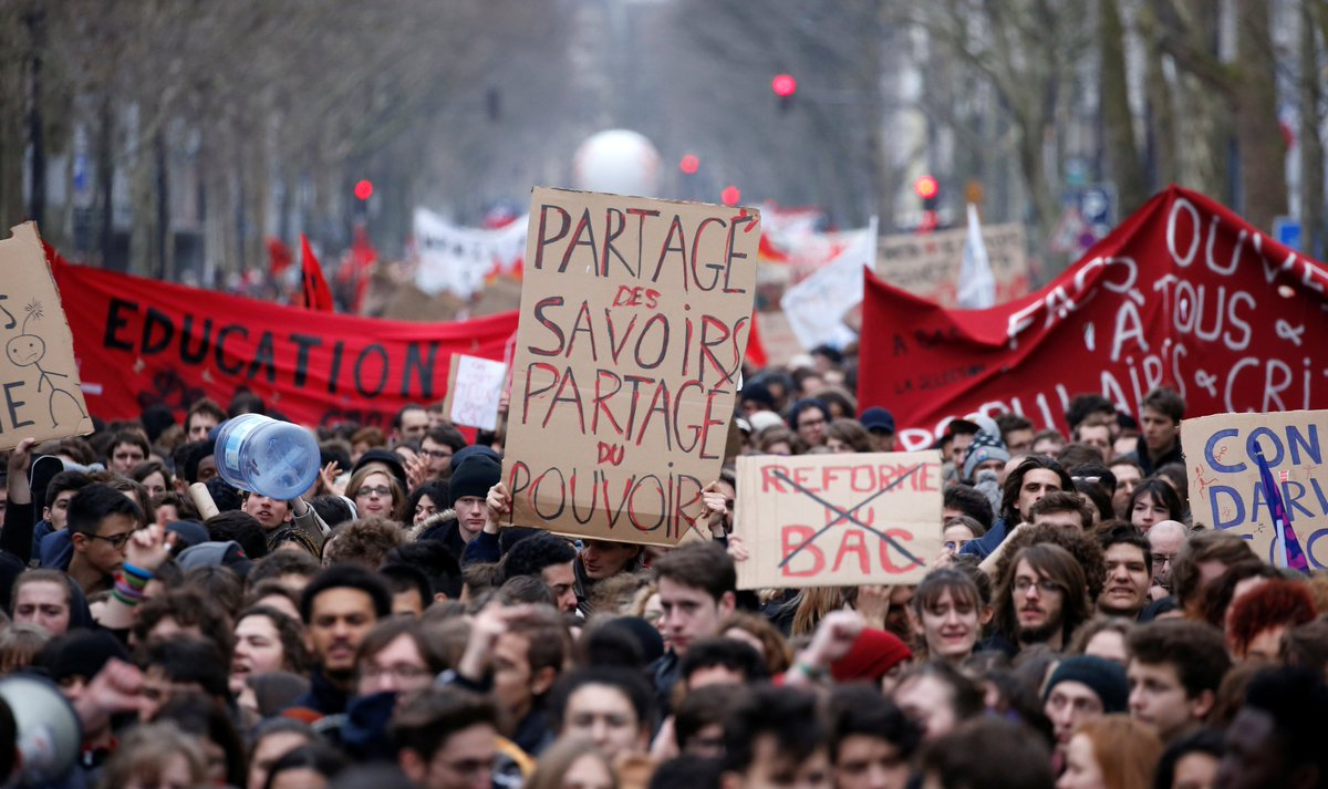 Tens of thousands of public sector workers, led by rail workers and air traffic controllers, went on strike Thursday, protesting across France against President Macron's proposed job and budget cuts.