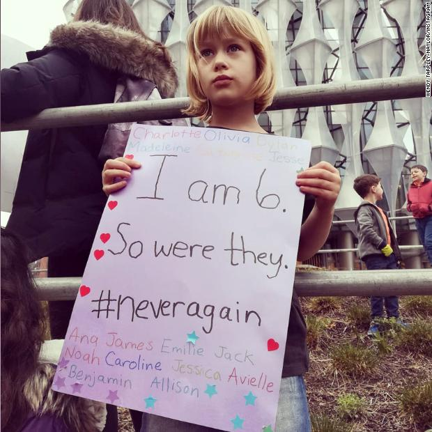 This 6-year-old is marching in London today carrying a sign with the names of the victims of the 2012 Sandy Hook massacre. 'I am 6. So were they,' the sign reads. https://t.co/TzVGMhElks