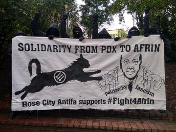 Solidarity From PDX to Afrin Banner with Antifa cat attacking Erdogan. Rose City Antifa supports #Fight4Afrin