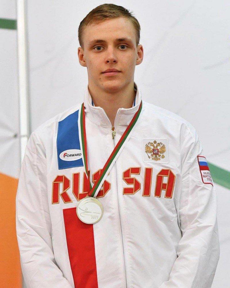 делийской фотографии спортсменов с медалями переднем