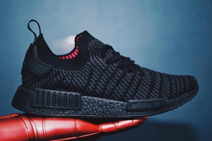 626953c6406f8 The blacked-out adidas NMD R1 STLT in