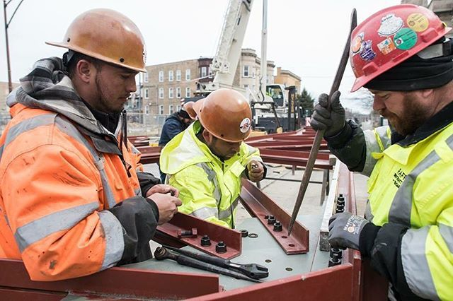 Immigrants building America. Iron workers prepare the first of six roof trusses for lifting and installment at Shrine of Christ the King in the Woodlawn neighborhood of Chicago, Monday, March 26, 2018.  #immigrants #work #chicago #church #shrineofchristtheking pic.twitter.com/kvGVhHpiEQ