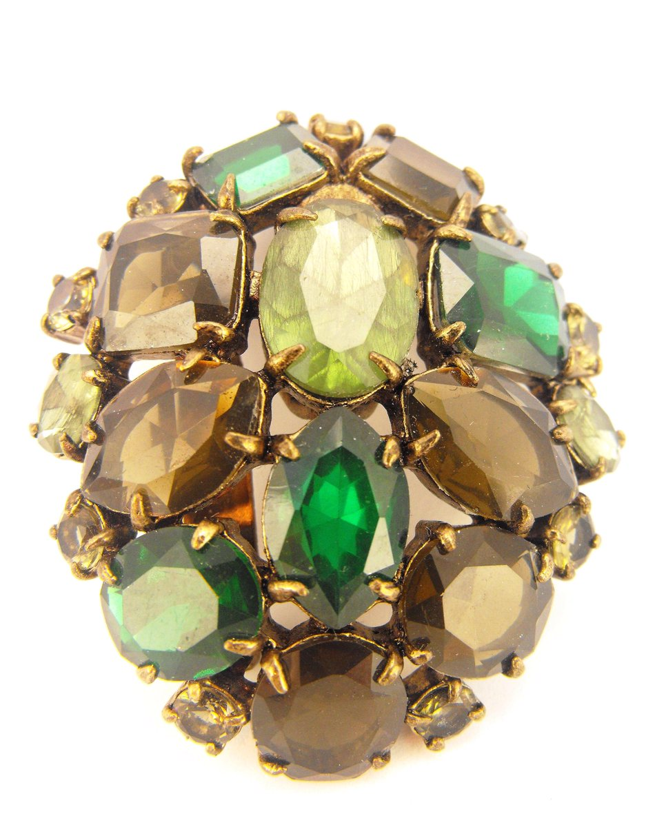 known quality pin as peridot it olivine polished magnesium is gem also forsterite gemstones variety of rich one gemstone few the stone