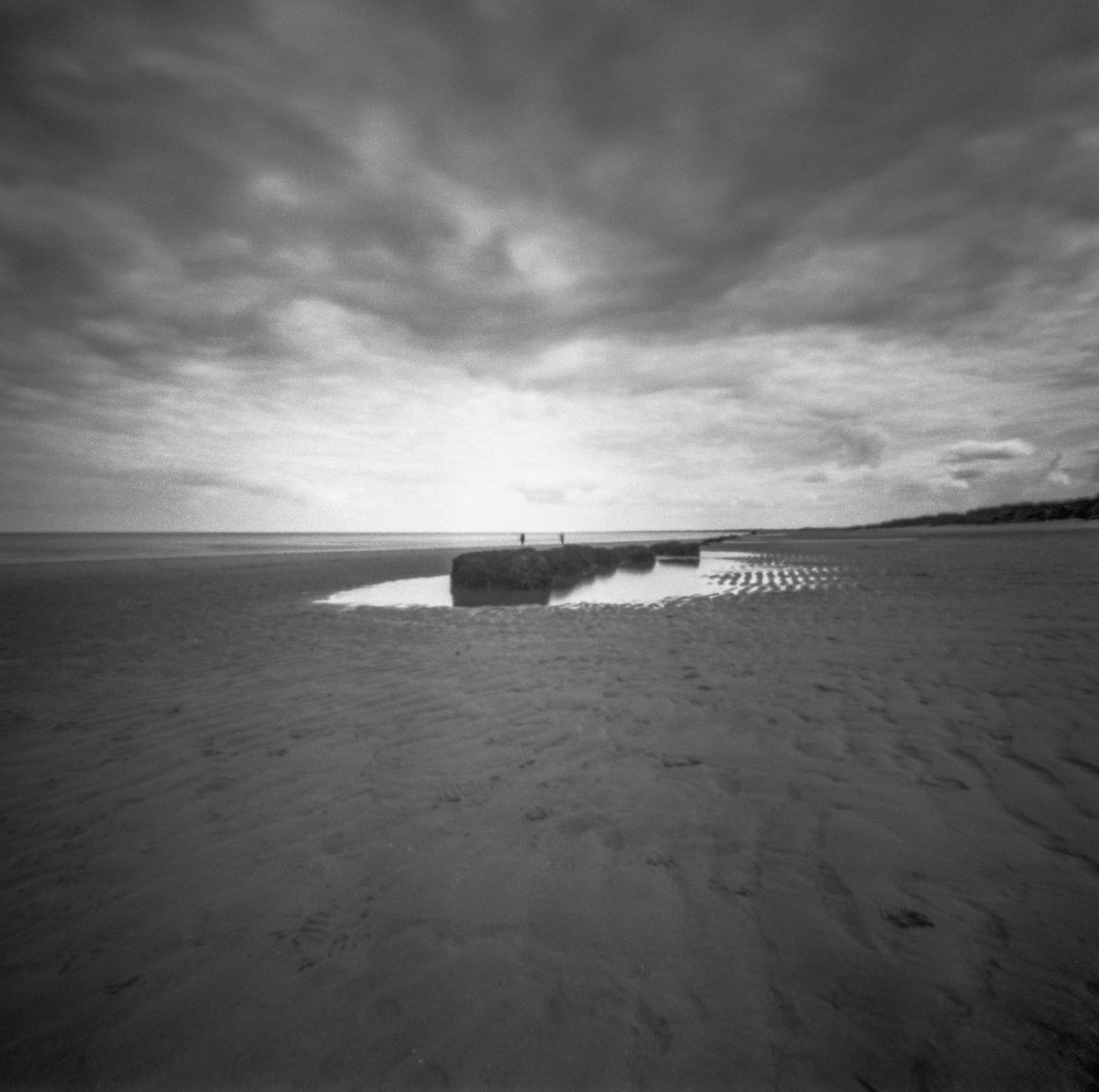 Peace on the beach #believeinfilm #blackandwhitephotography #Monochrome #pinholephotography #lensless #eastcoast #Yorkshire #mediumformat #6x6 #beach #ilford #panf