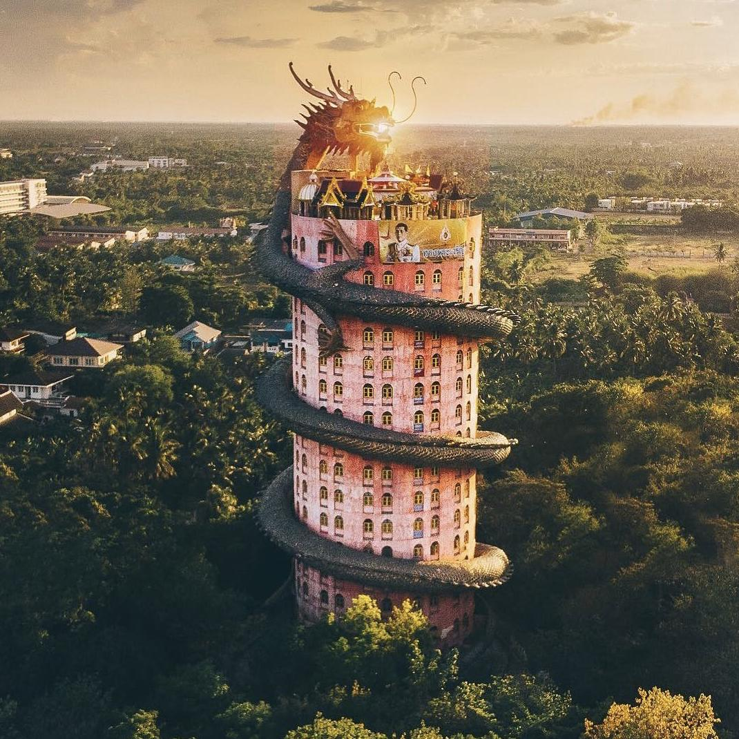 Outlandish and pink, and wrapped around with a gigantic dragon for good measure is the iconic building of Wat Sampran in Nakhon Pathom.   Constituting a great shot as seen here by @kanghwasong  #AmazingThailand #ReviewThailand <br>http://pic.twitter.com/CxEtuJIG4Z