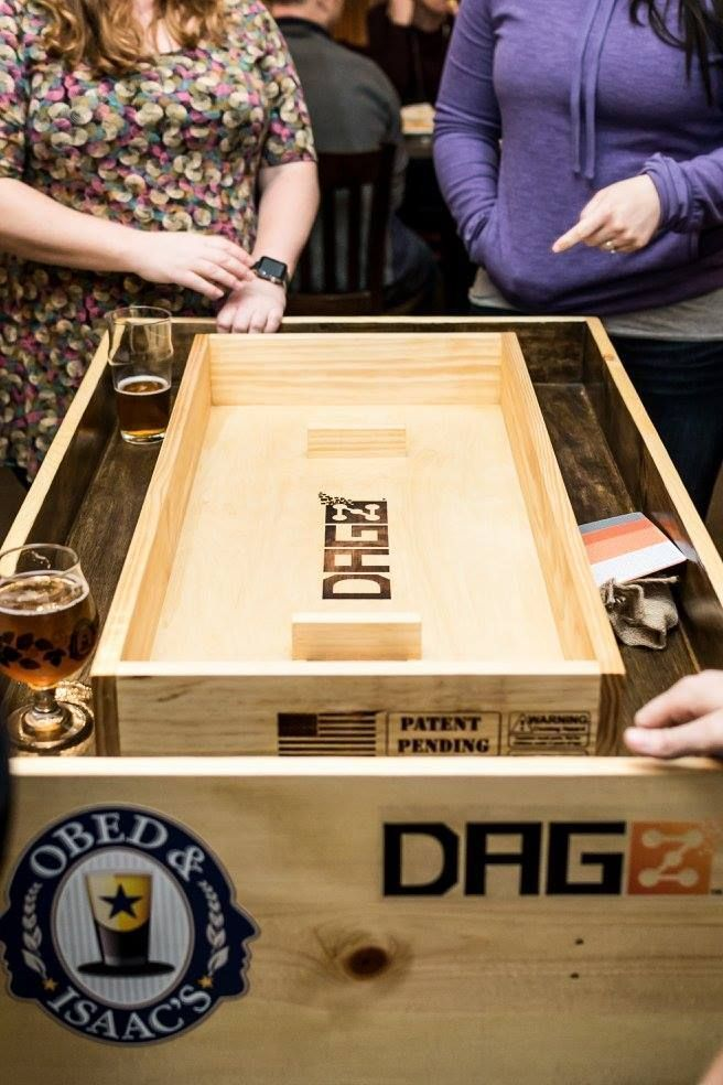 Have you heard of the hot new game called DAGZ? It is a dice game similar in concept to bags and on a much smaller scale.  #boardgames #dice #tabletopgames #playdagz #games #smallbusiness #bargames #giftidea #bargames  https://buff.ly/2k8zZ5L