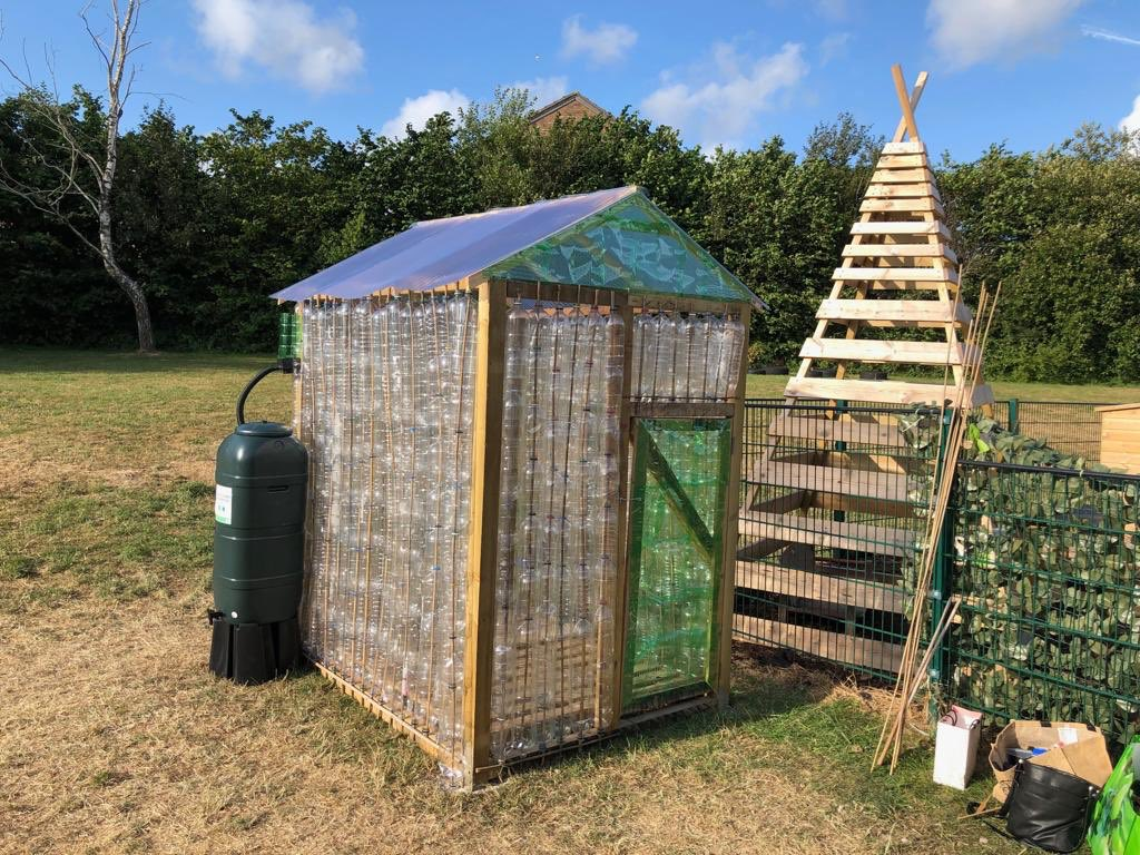 Bottle greenhouse completed. Thank you to everyone who helped. Thanks to Claire David and Robert Parfitt. Thank you to Homebase for providing some of the materials and the water butt. Special thanks to Mrs Butcher for running and completing the project. Diolch yn fawr! 😀 https://t.co/aNJReBjm0Z