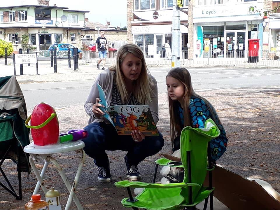 Please note @Essex_CC how these young library campaigners are enjoying books (at a library protest event). Paperback, hardback, with or without illustrations, offer an escape from tablets and screens. NO to the further depletion of book stocks #SaveOurLibraries #SaveOurBooks<br>http://pic.twitter.com/sBCCQ5feI5