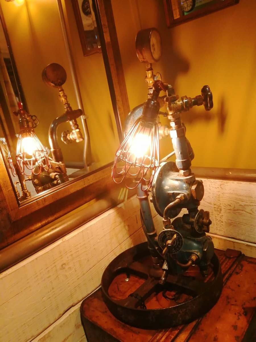 Just thought I'd share this, a cool lamp made out of various metal trinkets. A nice little representation of #steampunk
