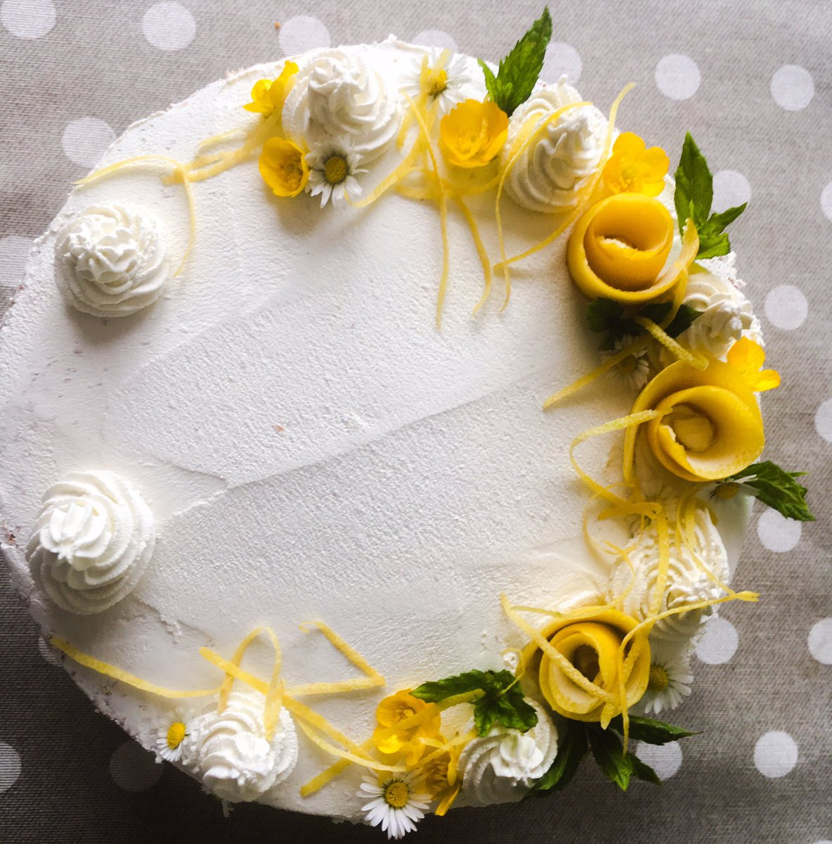 Love decorating cakes like this. Simple roses made of lemon peel for a lemon drizzle cake 🍋 #whitfieldcakes #instacakes