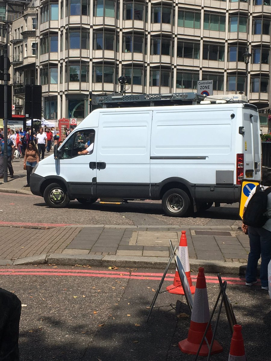 Anyone know who this van belongs to? It's taking video of all the marchers!