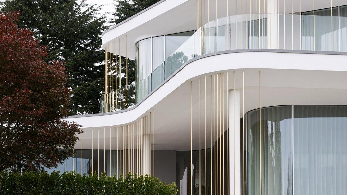 Curving terraces surround Villa Mosca Bianca by Design Haus Liberty: at.dezeen.com/2Jw9EqU