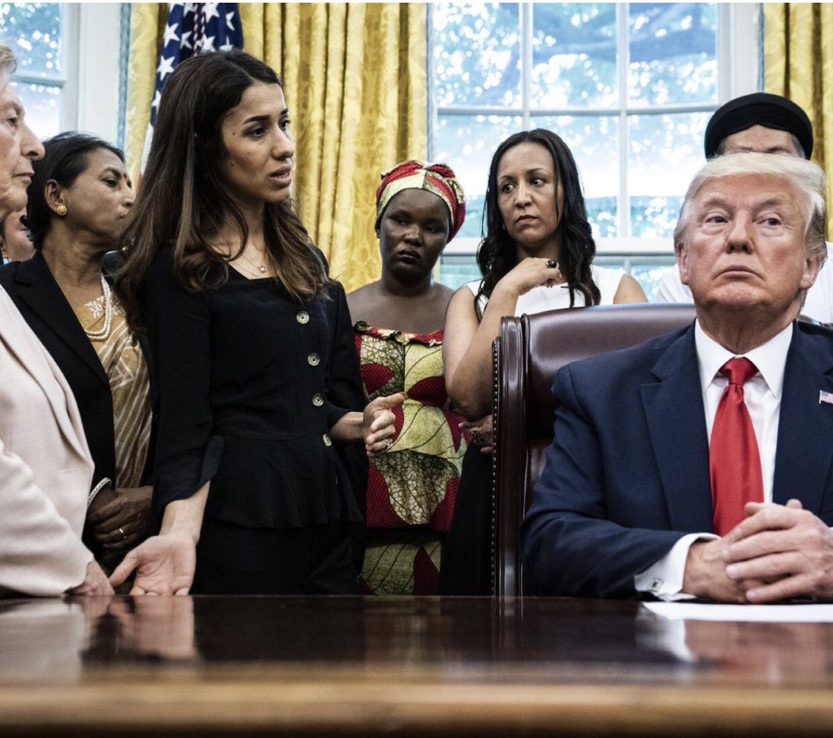 He looks like he's trying to decide between KFC or a Big Mac while she is telling him her whole family was murdered! Fuck Trump, Fuck the Republicans and Fuck MAGA! <br>http://pic.twitter.com/bZnYmB0vTc