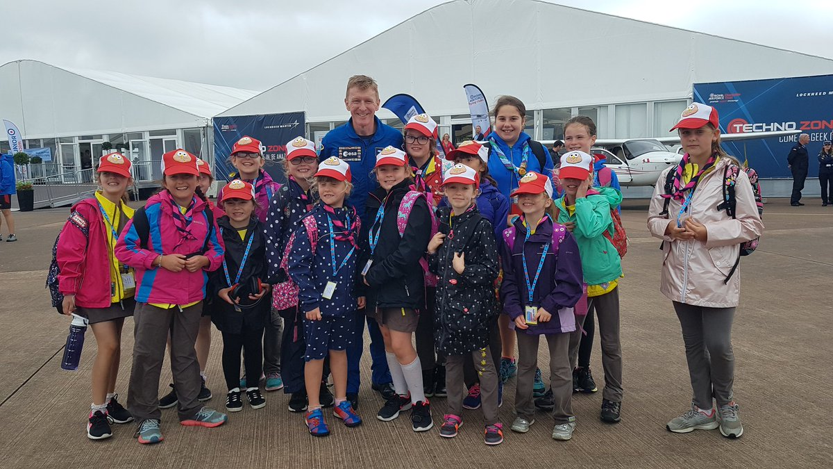 A MASSIVE thank you to @astro_timpeake for stopping to allow the Brownies a quick photo! @airtattoo #RIAT19 @GirlguidingGlos @GirlguidingSWE<br>http://pic.twitter.com/mGZYH08JoJ