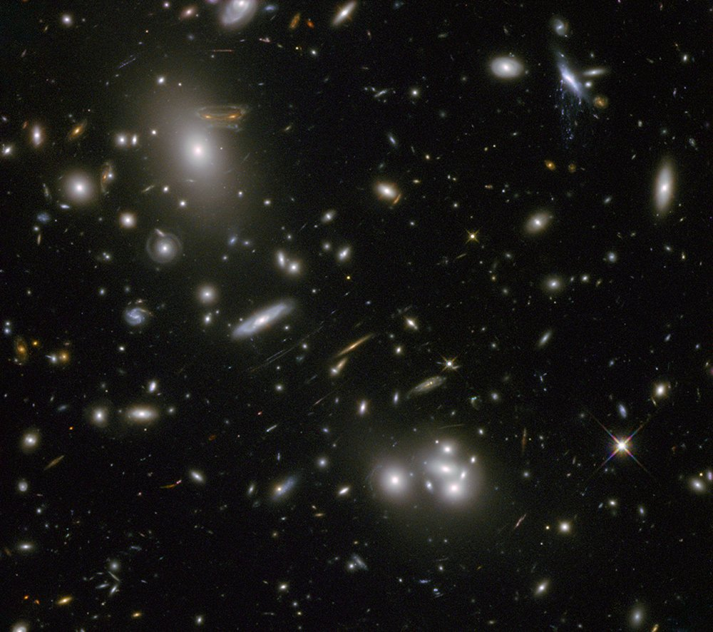 In this #HubbleClassic, the light from distant galaxies is being bent & stretched by gravity into weird arcs and shapes, including one that looks like an invading space alien. Check out Hubble pictures of this gravitational lensing phenomenon at: go.nasa.gov/32i5P0X