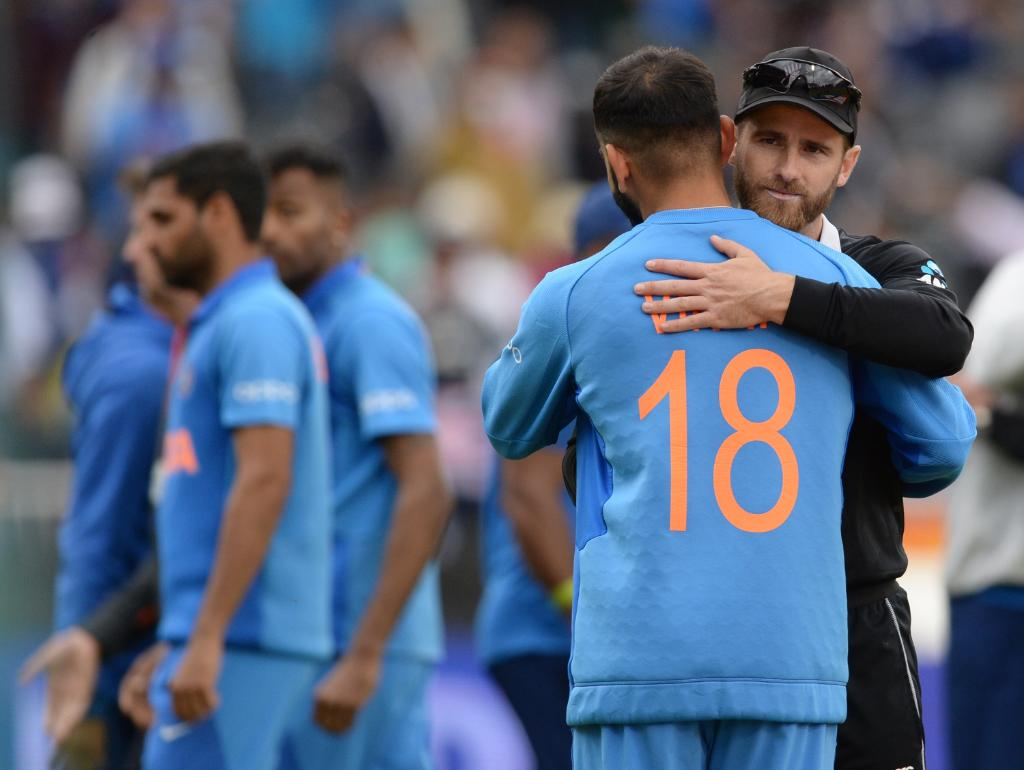The two captains embrace after a semi-final thriller 👏  #CWC19 | #INDvNZ