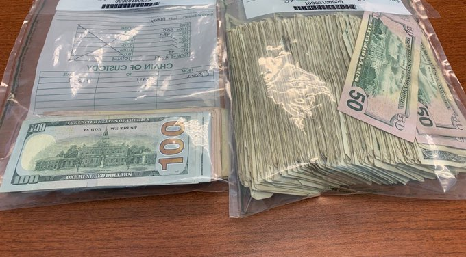 Closeup of money bags filled with cash returned by those who found it on I-285.