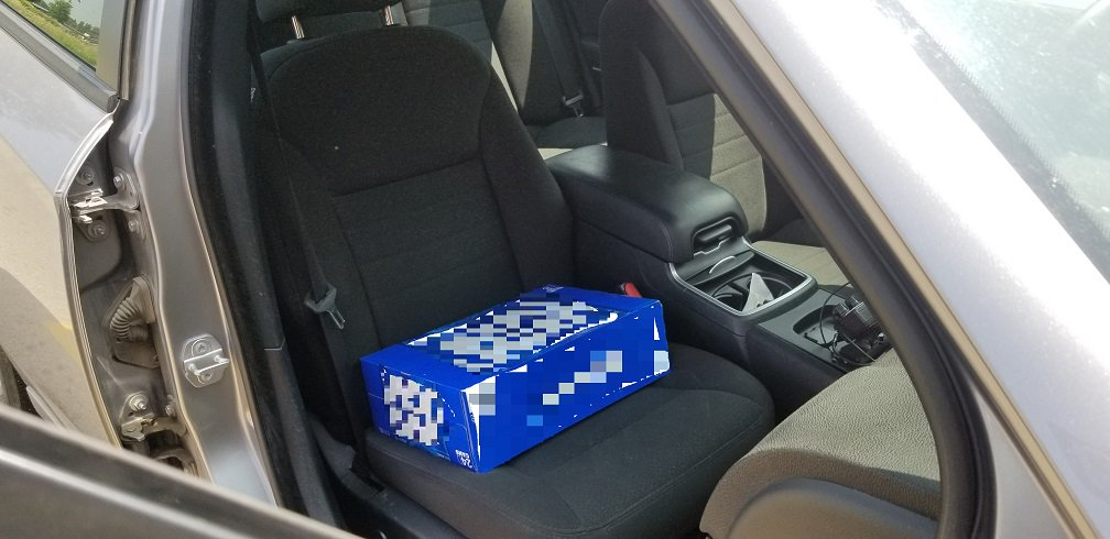 Canadian police catch man using case of beer as child booster seat