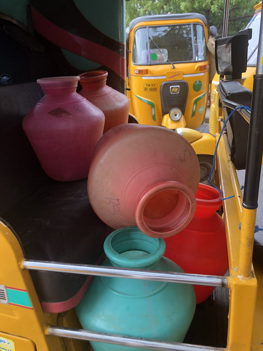 It's hot, muggy and there are these bright plastic water pots everywhere